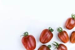 Закройте вверх по томату вишни на белой изолированной предпосылке Стоковое Изображение