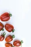 Закройте вверх по томату вишни на белой изолированной предпосылке Стоковая Фотография RF