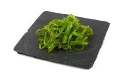 Закройте вверх по части зеленого салата морской водоросли wakame Стоковое фото RF