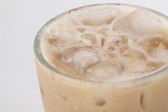 Закройте вверх по чаю льда с молоком над белой предпосылкой Стоковое фото RF