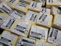 Закройте вверх распакованного блока сыра Стоковые Изображения RF