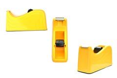 Закройте вверх резца клейкой ленты желтого цвета группы Стоковые Изображения RF