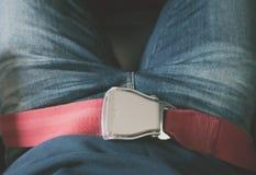 Закройте вверх ремня безопасности безопасности в самолете (Фильтрованное изображение p Стоковые Фотографии RF