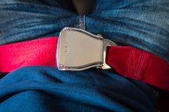 Закройте вверх ремня безопасности безопасности в самолете Стоковые Фото