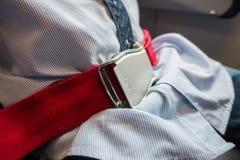 Закройте вверх ремня безопасности безопасности в самолете Стоковое фото RF