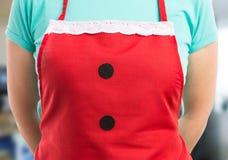 Закройте вверх рисбермы рождества красной с шнурком и кнопками Стоковые Изображения