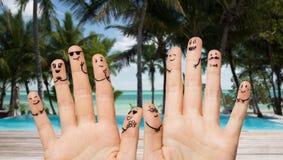 Закройте вверх рук и пальцев с сторонами smiley Стоковая Фотография RF