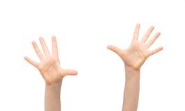 Закройте вверх рук маленького ребенка поднятых вверх Стоковые Изображения RF