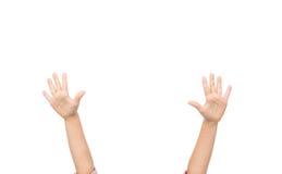Закройте вверх рук маленького ребенка поднятых вверх Стоковая Фотография RF