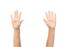 Закройте вверх рук маленького ребенка поднятых вверх Стоковое Изображение RF