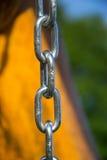 Закройте вверх серебряного стального звена цепи Стоковые Изображения