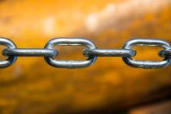 Закройте вверх серебряного стального звена цепи Стоковое Фото