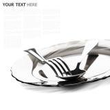 Закройте вверх серебряной ложки и вилки на белой предпосылке Стоковые Изображения RF