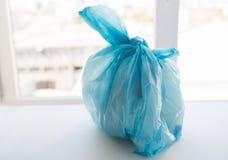 Закройте вверх сумки хлама с поганью дома Стоковая Фотография RF