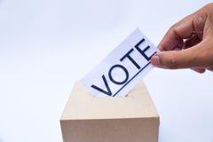 Закройте вверх урны для избирательных бюллетеней и решающего голоса Стоковая Фотография