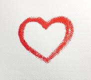 Закройте вверх формы сердца губной помады на белой предпосылке Стоковые Изображения RF