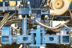Закройте вверх цепи на шестерне на аграрной машине стоковое изображение rf