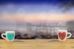 Закройте вверх чашки влюбленности стоковые изображения rf