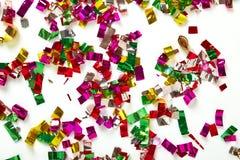 Закройте вверх confetti на белой предпосылке Стоковые Изображения