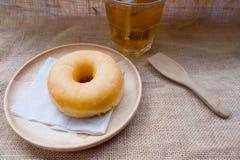 Закройте вверх donuts застекленных с сахаром Стоковые Изображения