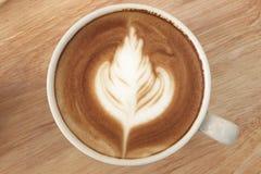 Закройте вверх latte кофе на верхней части, чашке кофе Стоковое фото RF