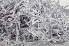 Закройте вверх shredded бумаги для предпосылки. Стоковое фото RF