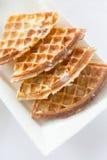 Закройте вверх waffles на плите на таблице завтрака Стоковое фото RF