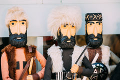 Закройте 3 деревянных куклы в Similitude горцев, Кавказе Стоковое Фото