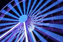Закручивая колесо ferris на свете ночи Стоковая Фотография
