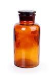 Закрытая медицинская бутылка коричневого стекла цвета Стоковое Изображение