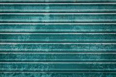 Закрытая предпосылка двери ролика teal Стоковое Изображение RF
