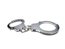 Закрытые наручники на белой предпосылке Стоковые Фотографии RF