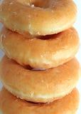 Закрытый вверх по стогу сахар-застекленных Donuts, вертикальное фото для предпосылки Стоковые Фотографии RF