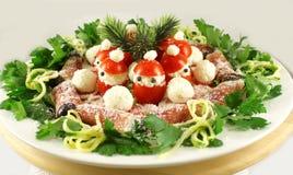 Закуска рождества с томатами Санта Клауса Стоковая Фотография