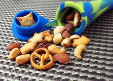 Закуска студента, различные гайки в трубке силикона Стоковая Фотография