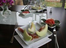 Закуска с дыней меда и ветчиной Serrano Стоковое Изображение RF