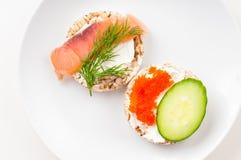 Закуски с красными рыбами и красной икрой Стоковые Фото