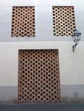 Закладыванная кирпичами дверь и Windows Стоковое Изображение