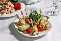Замаринованные огурцы, заполненные баклажаны, и томат Стоковая Фотография