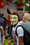 Замаскированный активист на митинге протеста Сингапуре праздника Первого Мая стоковые фото