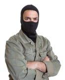 Замаскированный взломщик смотря камеру стоковая фотография rf