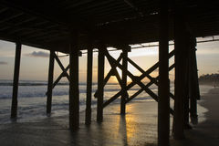 замаскированный заход солнца пристани Стоковые Фото