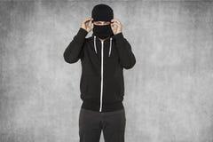 Замаскированный человек покрывает его сторону Стоковое Изображение