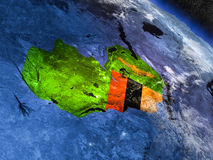 Замбия с врезанным флагом от космоса иллюстрация вектора