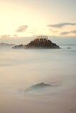 Замедляйте shutterspeed изображение на заходе солнца Стоковое Изображение