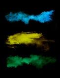 Замерзните движение покрашенных взрывов пыли на черноте стоковое изображение rf