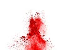 Замерзните движение красного порошка взрывая, изолированное на белой предпосылке стоковое фото rf