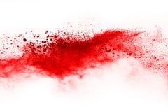 Замерзните движение красного порошка взрывая, изолированное на белой предпосылке стоковые изображения rf
