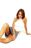 замкните накоротко сидя женщину юбки Стоковые Фотографии RF