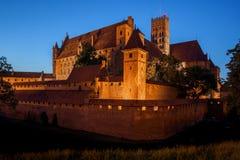 Замок Мальборка к ноча Стоковая Фотография